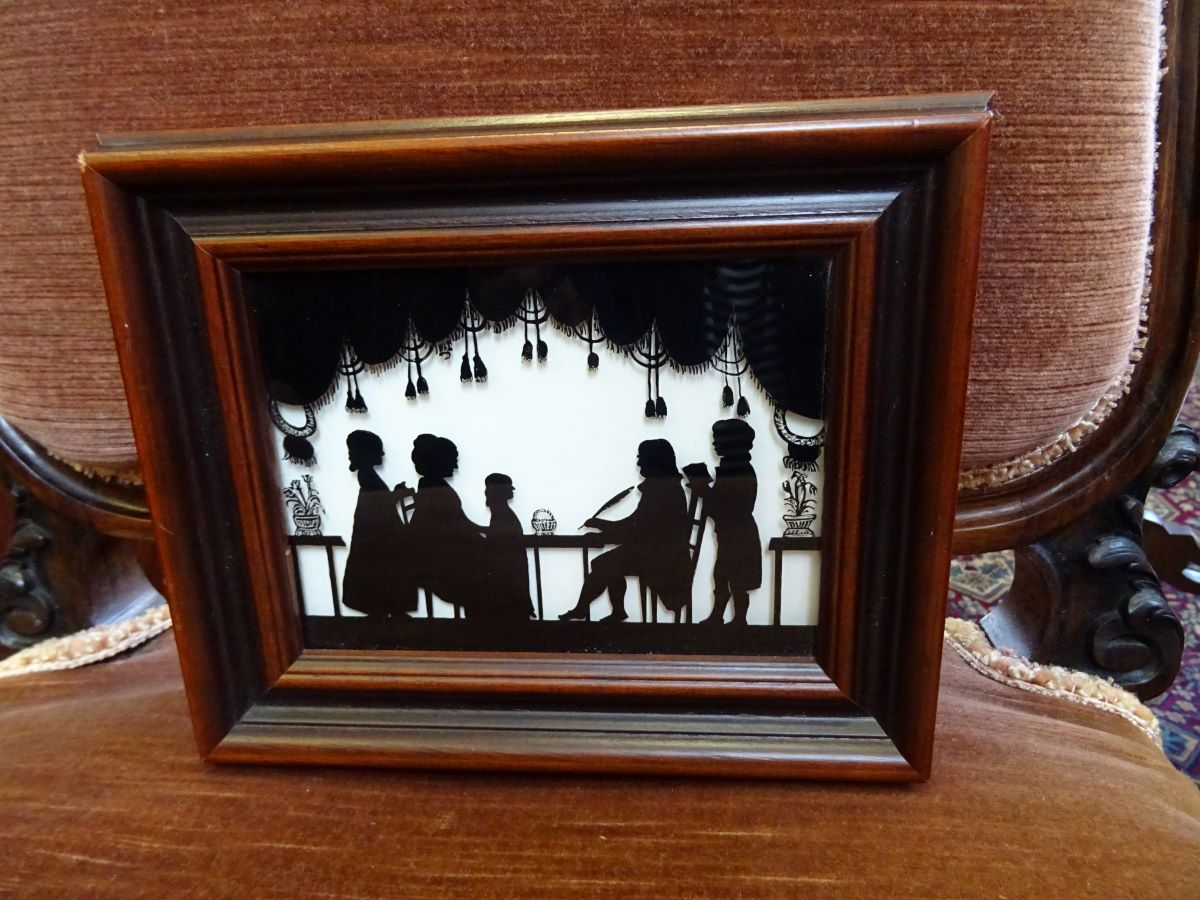 Reverse painting on glass of family