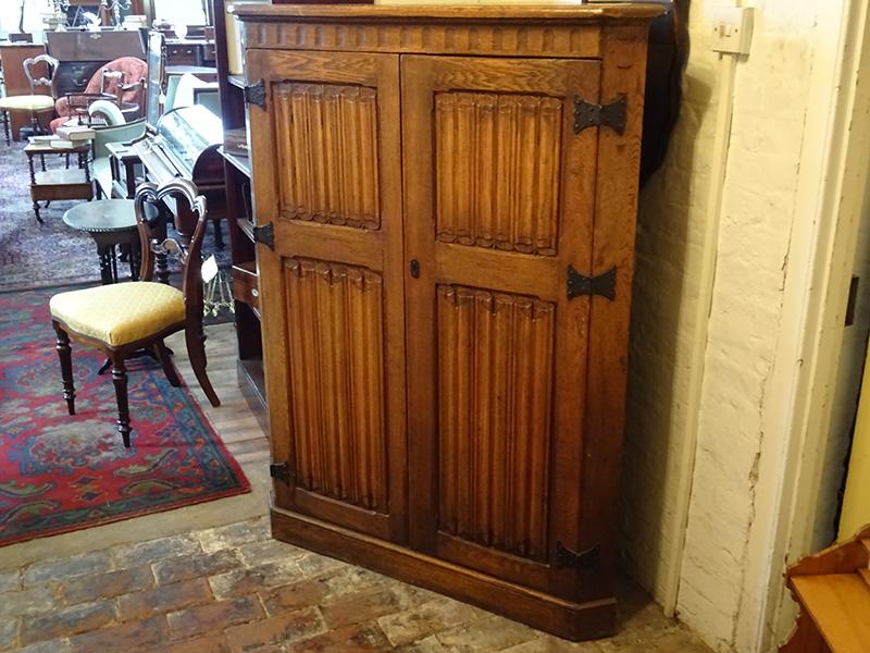 Vintage oak linenfold corner cupboard