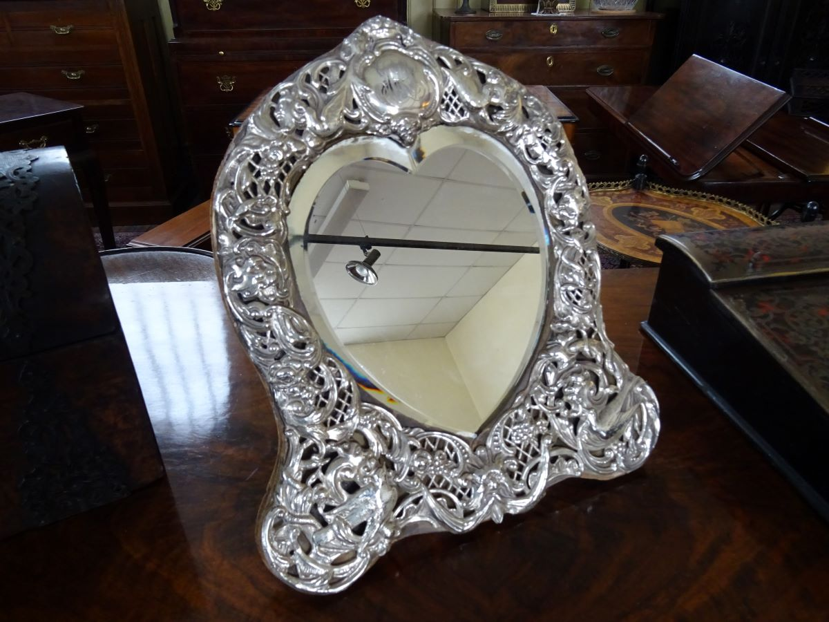 19th century silver fronted heart-shaped mirror