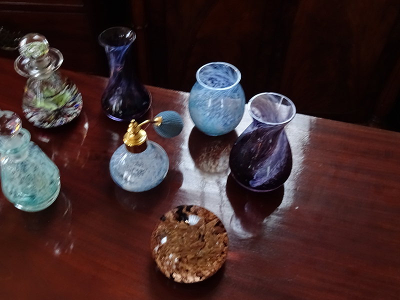 Collection of glass perfume bottles and vases