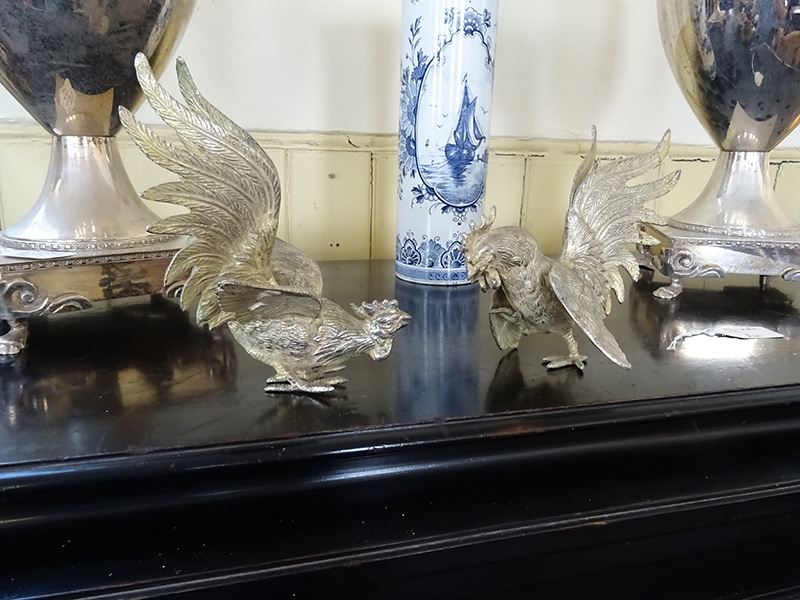 Silver plate fighting cocks