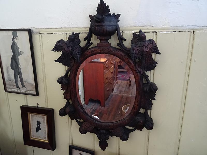 Ornate oak bevelled mirror, possibly Black Forest